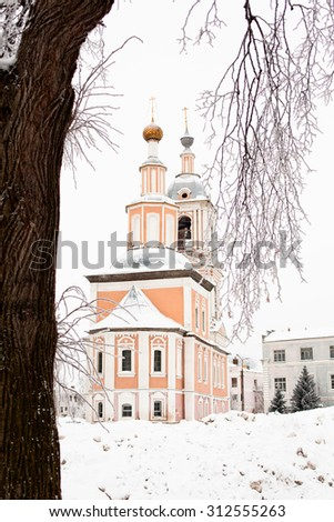 White and yellow church in winter in Uglich