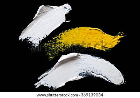 white and yellow   grunge brush strokes oil paint on black background - stock photo