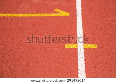 white and yellow line on red track texture background