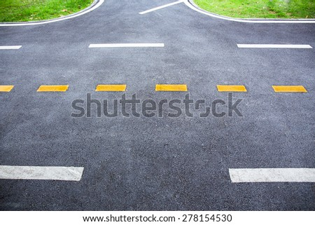 white and yellow line on the road texture. - stock photo