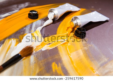 White and yellow tempera color tubes - stock photo