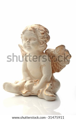white angel with clay - stock photo