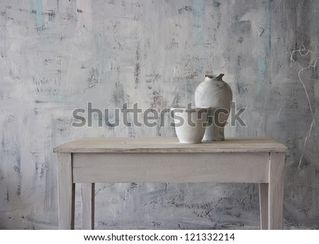 White antique vase in white interior. - stock photo