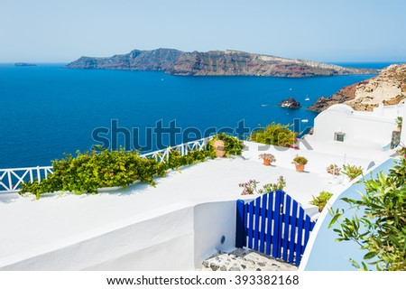 White architecture in Oia town on Santorini island, Greece. Beautiful landscape with sea view - stock photo