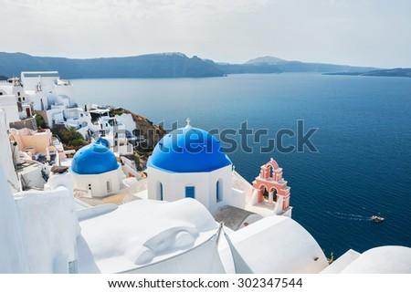 White architecture in Oia town, Santorini island, Greece. Beautiful landscape with sea view.  - stock photo