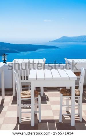 White architecture on Santorini island, Greece. Beautiful cafe with sea view.  - stock photo