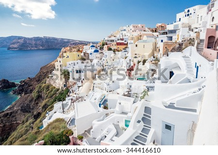 White architecture on Santorini island, Greece. Beautiful landscape with sea view and blue domes - stock photo