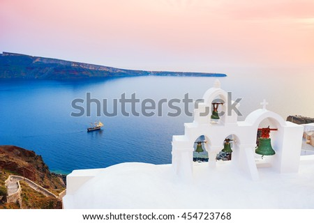 White architecture on Santorini island, Greece. Beautiful summer landscape at sunset, sea view