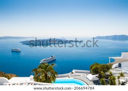 White architecture on Santorini island, Greece. Beautiful view on the sea - stock photo