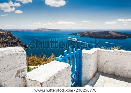 White architecture on Santorini island, Greece. Terrace with sea view. Small depth of sharpness - stock photo