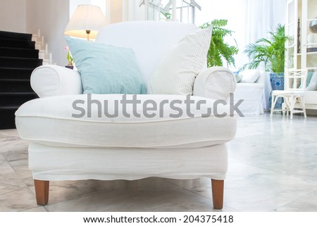 white armchair with pillow in living room ,vintage style - stock photo