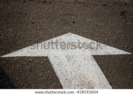 White arrow on the road background