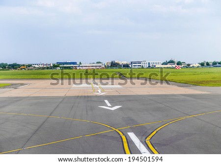 white arrows at airport runway landing zone - stock photo