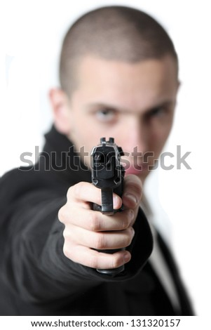 White background holding a gun.