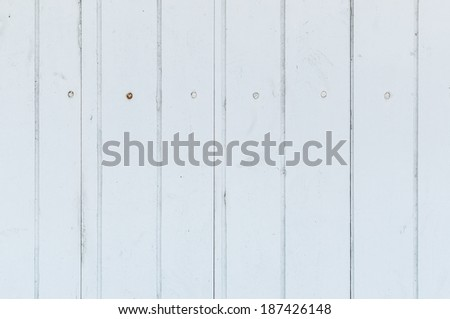 White background of weathered painted wooden plank - stock photo