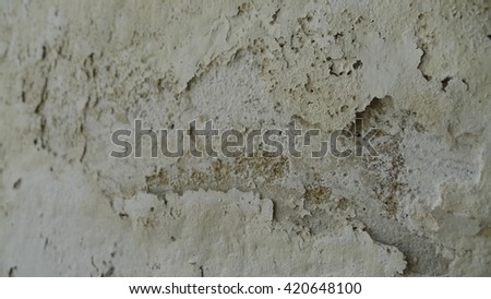 White background. Old paint cracked. Background in grunge style. Water pipe leaking causing moist problem - stock photo