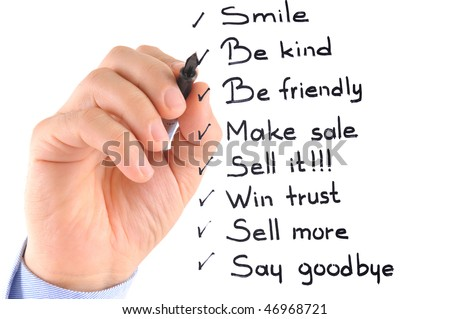 White background studio image of a businessman's hand writing daily work procedures on glass