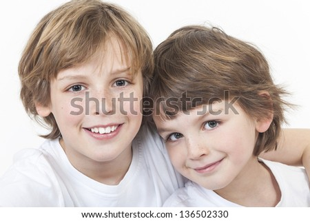 White background studio photograph of young happy boy children brothers smiling together