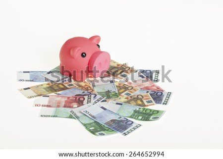 white background with euro banknotes and a pink piggy bank. financial concept for saving and interest - stock photo