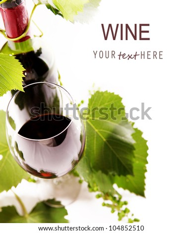 White background with goblet, bottle and vine 1 - stock photo