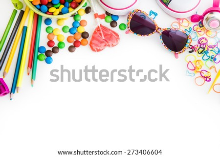 white backgrounnd with colourful childre's sweets and stuff