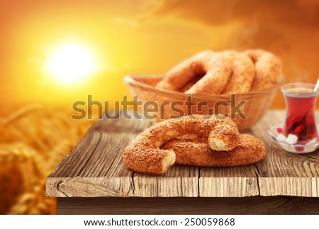 White bagel, turkish tea with natural background - stock photo