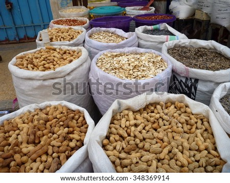 white bags with colorful spices and nuts sold at the asian market - stock photo