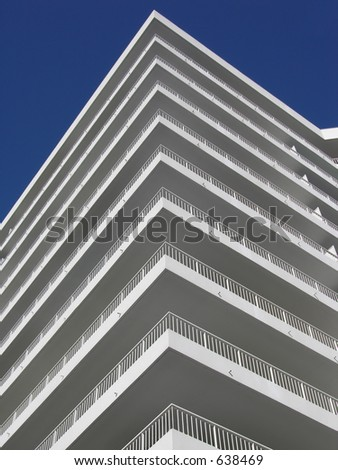 White balconies and a blue sky.