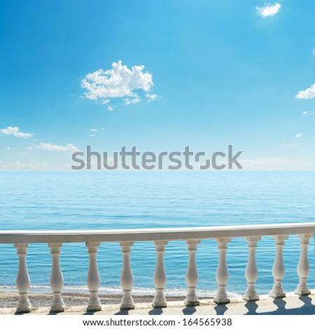 white balcony over sea and blue sky - stock photo