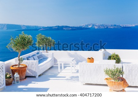 White balcony overlooking famous Santorini volcanic caldera, Oia, Santorini, Greece - stock photo