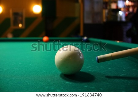 White ball  in a billiard table and cue