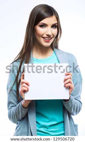 White banner .Teenager girl hold white blank paper. Young smiling woman show blank board. Close up female model portrait isolated on white background. - stock photo
