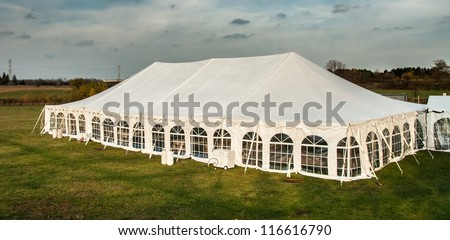 White banquet wedding tent or party tent at twilight time - stock photo
