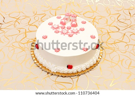 White baptist cake for girl with pink decoration - stock photo