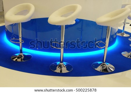 white bar chairs in technological interior