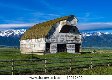 White barn near the Wallowa Mountains in Oregon - stock photo
