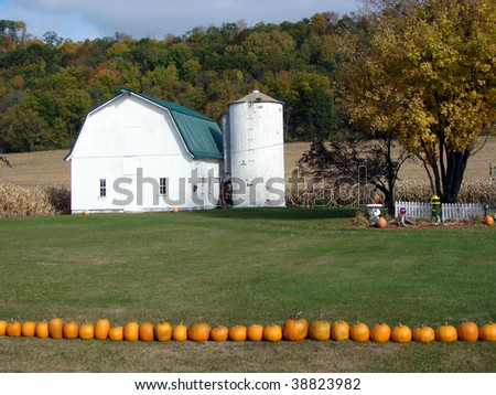 white barn silo fall foliage pumpkins