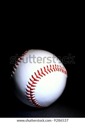 white baseball against dark background vertical - stock photo