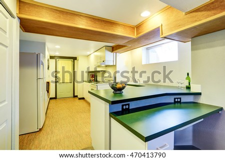 White basement kitchen room with green counter tops and linoleum flooring. Northwest, USA