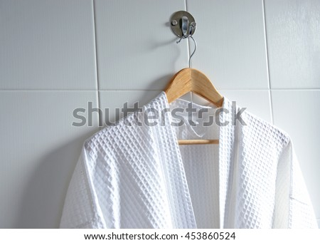 White bathrobe on hanger