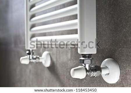White bathroom heater closeup on gray wall - stock photo