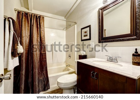 White bathroom interior with brown elements - stock photo
