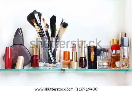 white bathroom shelf with cosmetics and  toiletries - stock photo