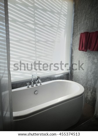 White bathtub with red towell