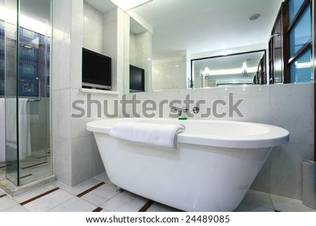 white bathtub with towel in bath room