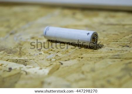 White battery AAA on recycle wood background
