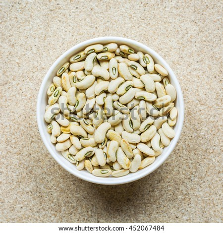 White beans, Cow Pea. Colorful various beans or lentils and whole grains seeds or cereal in white cup on wood background. - stock photo