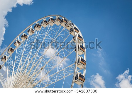 White Beautiful large Ferris wheel with blue sky background - stock photo