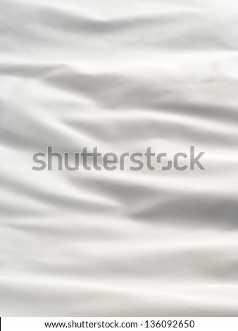 White bedding sheet with folds - stock photo