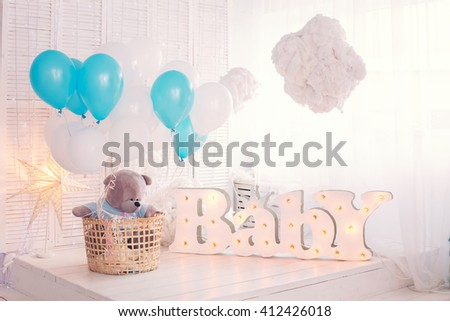 White bedroom with blue decorations designed and  teddy bear ideal for both boys and girls - stock photo